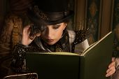 image of steampunk  - Portrait of a beautiful steampunk woman over vintage background - JPG