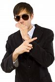 foto of bodyguard  - Caucasian male bodyguard wearing sunglasses and black suit - JPG