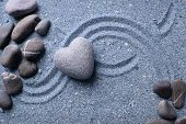 foto of pumice stone  - Grey zen stone in shape of heart - JPG