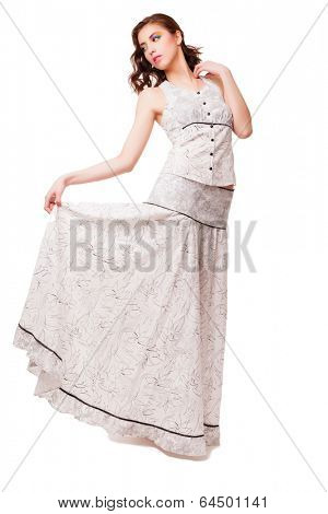 Young attractive woman with long dress on white background