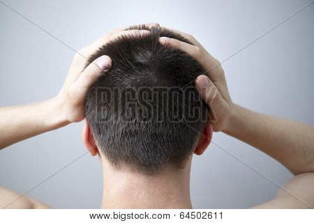 Headache Of The Man On Gray Background