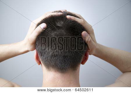 Headache Of The Man On Gray Background