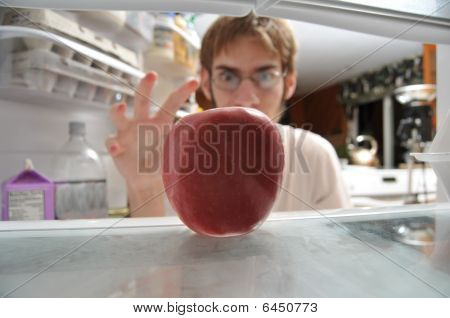 Man Snatching Apple From Fridge