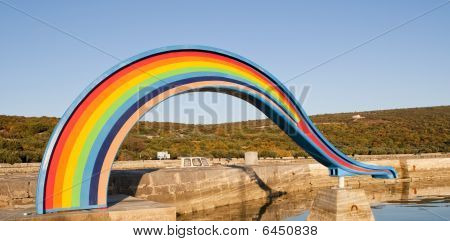 Rainbow Water Slide On A Beach