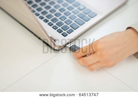 Closeup On Business Woman Putting Usb Flash In Laptop