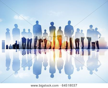 Silhouttes of Business People Looking Up in a Cityscape