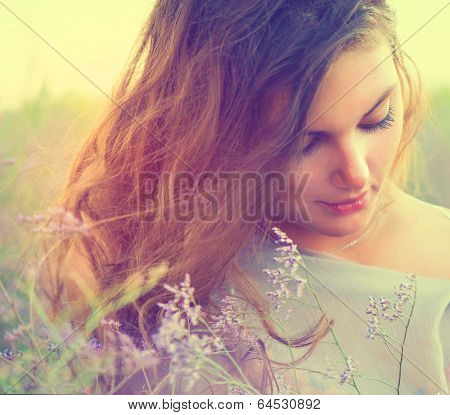 Beauty Romantic Girl Portrait. Sensual Woman Lying on a Meadow with Violet Flowers. Beautiful Woman  poster