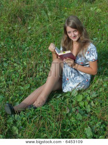 Girl Reading A Book Outdoor