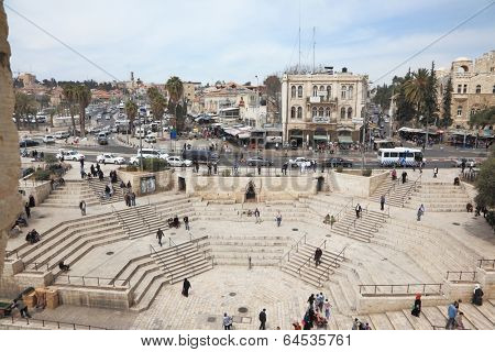 JERUSALEM, ISRAEL - MARCH 31, 2012: East Jerusalem from the walls surrounding the eternal city. The colossal marble staircase descends to the Damascus Gate