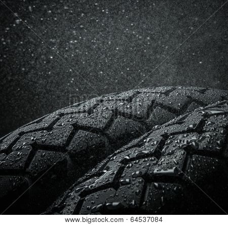 Close-up shots of classical motorcycle tires tread in wet weather condition