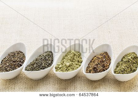 bowls of seaweed diet supplements (bladderwrack, sea lettuce, kelp, wakame and Irish moss) on burlap canvas with a copy space