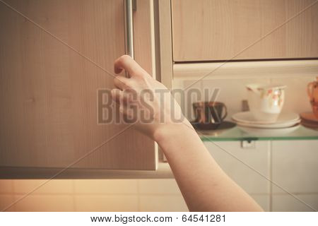 Hand Opening Kitchen Cupboard