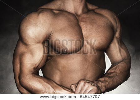 Close-up of muscular man with strong biceps