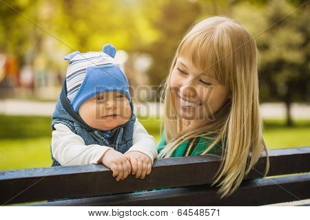 Happy mother and baby in the park