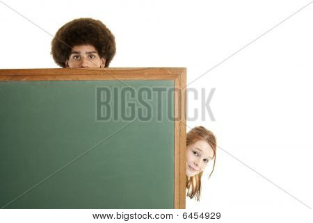 Teens With Blank Chalkboard