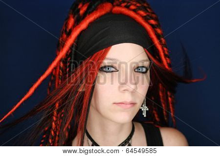 Girl with red dreadlocks