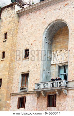 Monks Are On Balcony In Montserrat Benedictine Monastery, Spain