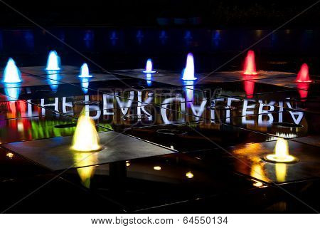 Colourful Peak Galleria fountains lit at night