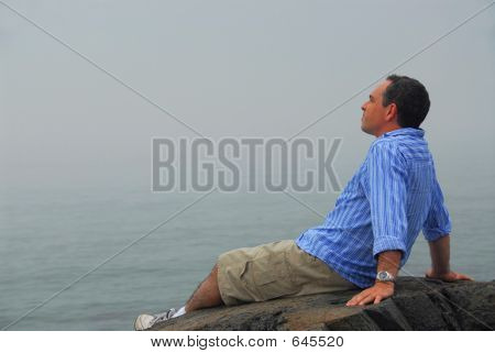 Man Looking Fog