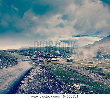 Vintage retro effect filtered hipster style travel image of Road in Himalayas on top of  Rohtang La pass, Himachal Pradesh, India
