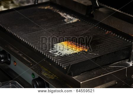 dirty electrical grill in real industrial kitchen