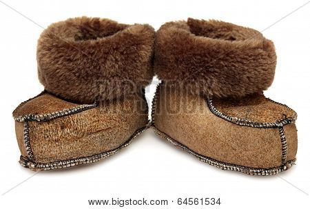 Children's shoes. Baby fur booties isolated on  white background.