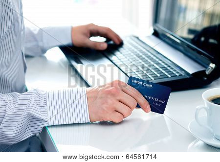 Businessman Making A Card Payment On The Internet