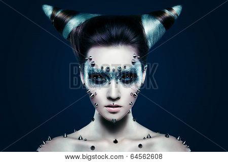 Demon girl with spikes on the face and body