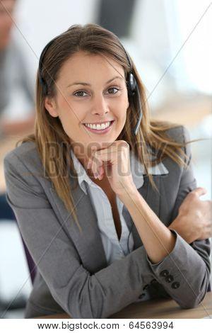 Smiling customer service representative at work