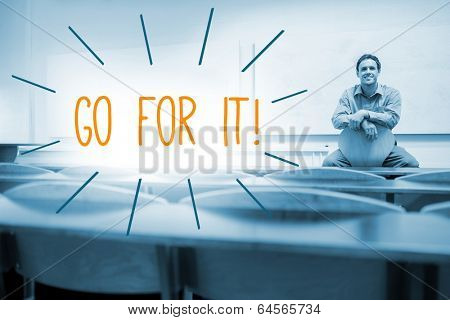 The word go for it! against lecturer sitting in lecture hall