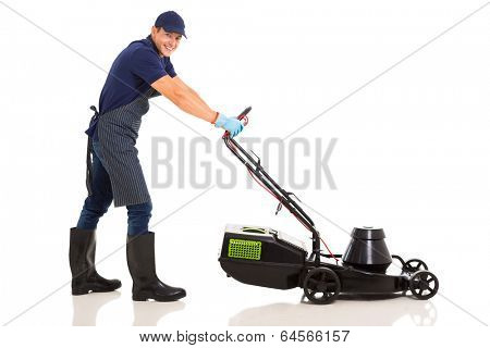professional male gardener using a lawnmower