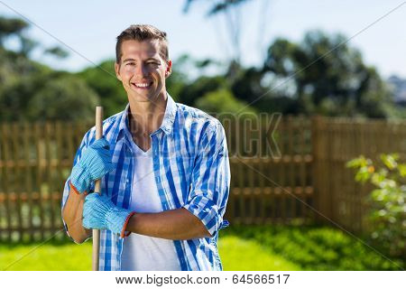 handsome young man cleaning home garden