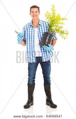 portrait of young man with gardening tool and plant isolated on white