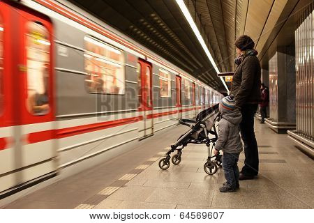 Family Looking At Train