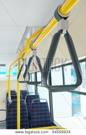 Handles for standing passenger inside a bus