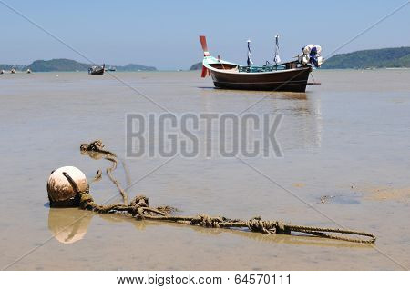 Traditional Thai Boat During Ebb