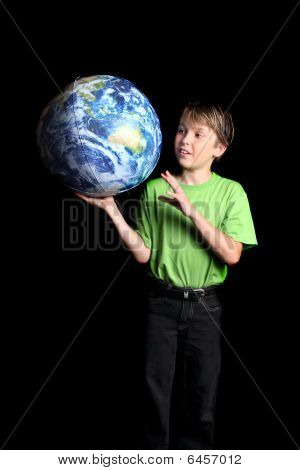 Boy Holding Earth In His Hand And Looking With Wonder Fascination