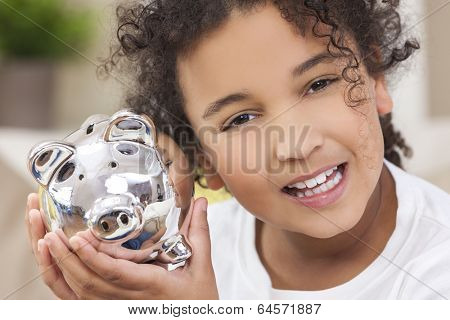 Beautiful happy young mixed race interracial African American female girl child smiling and holding a silver young saver piggy savings money bank