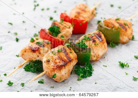 Grilled chicken skewers with paprika