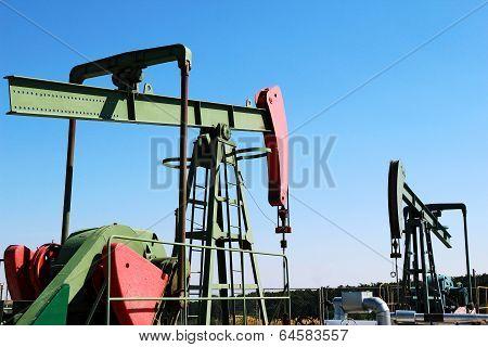 Two Oil Pumps Jacks Under Blue Sky