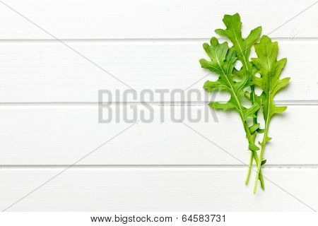 the fresh arugula leaves on kitchen table