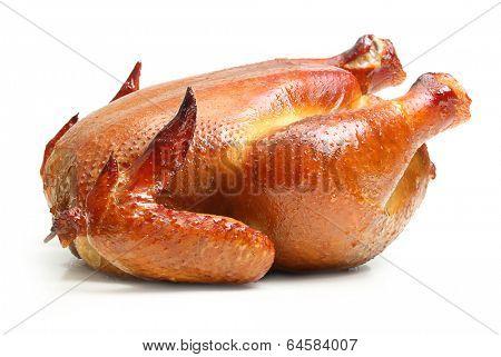 Roast chicken isolated on white background.