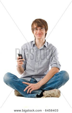 Young Man Using Mobile Phone For Sms