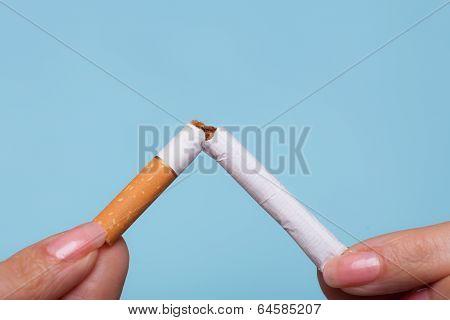 Addiction. Hands Breaking Cigarette.