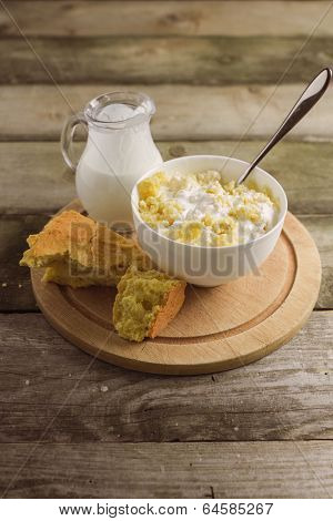 Cornbread and milk, on old wooden table