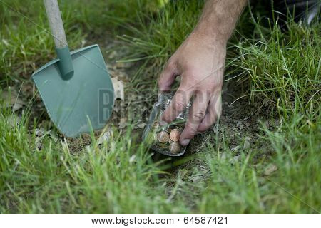 Man hand digging savings