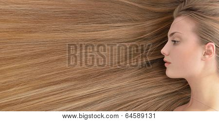 Fair hair. Beautiful young woman with  long healthy hair.