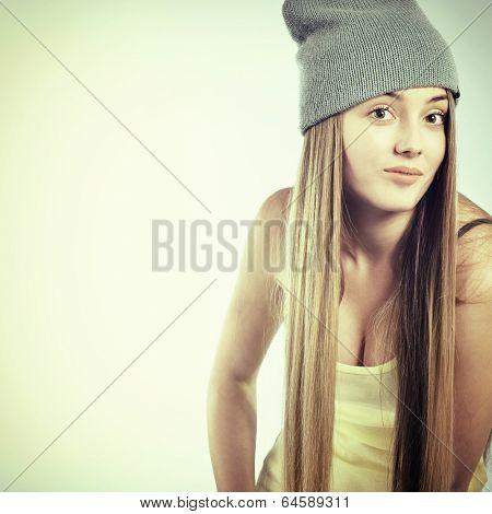 Beautiful joyful girl hipster looking at camera and smiling