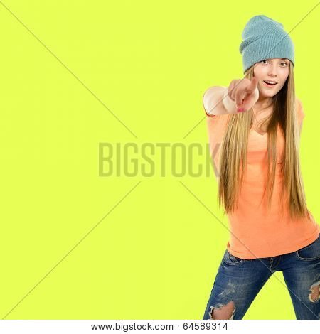 Beautiful joyful girl hipster pointing at you over acid yellow-green background