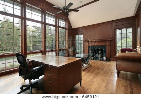Library With Wood And Marble Fireplace